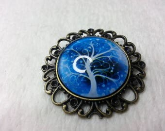Round blue cosmic tree brooch