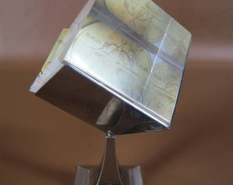 Twirling vintage lucite photo cube on monogrammed silver stand