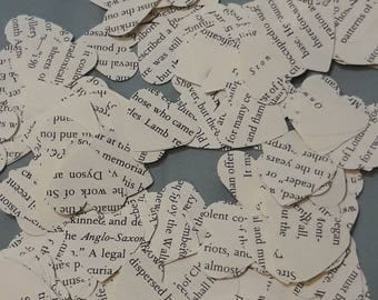 Heart shaped paper confetti. Made from pages out of books. Paper punch