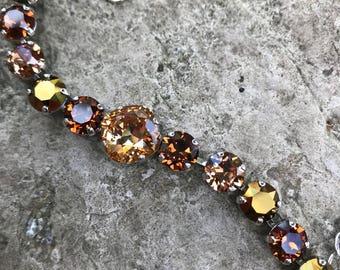 12 and 8mm brown tone swarovski bracelet