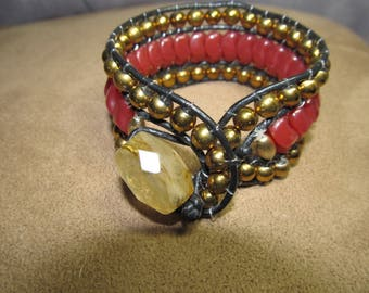 Hand stitched beaded leather bracelet