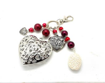 A scent! silver plated bag charm, red beads heart charms
