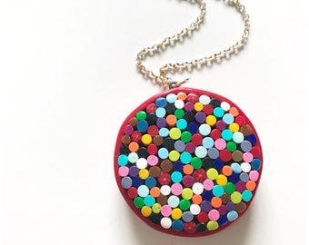 Macro mosaic pendant made entirely with polymer clay, hung on a nickel free chain