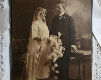 Vintage Wedding Photo.Bride and Groom.Edwardian.Victorian.1920s.Black and white.Sepia.Vintage wedding dress.Veil.Flower bouquet.Ephemera.