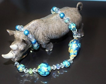 Black Rhino Design Single Strand Necklace Teal Blue Marble Look Paint Splattered Beads Ice and Aurora Borealis Crystals Pretty Closure