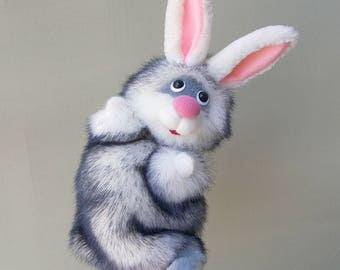 Winter hare. Cheerful and fluffy. Hand puppet. Bibabo. Toy glove. Toy on hand. Marionette. Puppet theatre.