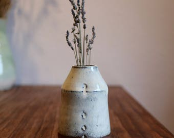 Potter's Stash: Small thrown and altered vase with Nuka wood ash glaze