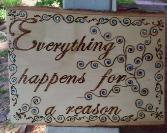 Wood burned painted and embellished plaque with spiral vines with blue crystals and inspirational saying Everything happens for a reason.