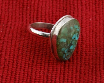 Turquoise ring made of crushed Turquoise and epoxied  to gather together to form a unique look.