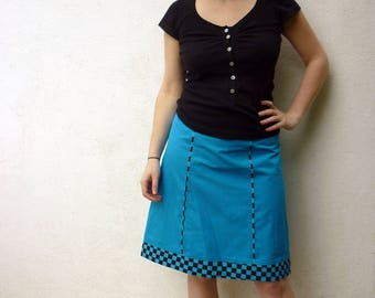 Turquoise panels and turquoise and black checkered skirt