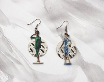 Novelty Plastock Women on Inky Background Drop Earrings