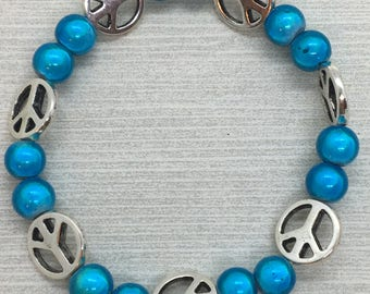 Blue Beaded Bracelet with Peace Signs