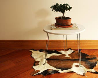 Cowhide rugs for home decor. Brown authentic cow hide area rugs. Small handmade exotic cowhide rugs for sale. Indoor leather rug. cow skin