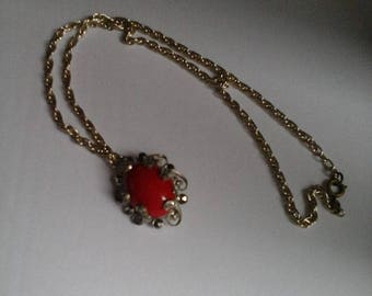 Vintage Red Glass Pendant Inset Silver and Rhinestone Filagree Setting.