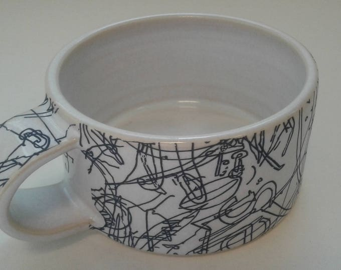 Short ceramic mug by Gosia Wlodarczak in collaboration with Maria Lieberman