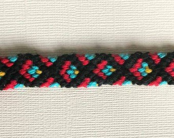 Red,black,teal and yellow  macrame bracelet