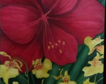 Red amaryllis flower and small yellow orchids