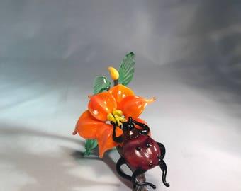 Ladybird  with orange flower composition