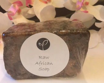 African Black Soap 100% Natural Raw Soap. Traditionally used for eczema, acne, dark spots, dryness & sensitive skin. Unscented