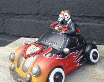 Hotrod car piggy bank with skeleton couple