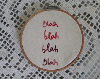 "Frame with handmade embroidery ""blah blah blah"""