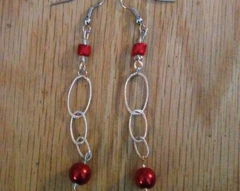 Silver and red dangled earrings