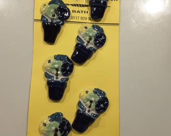Set of six hand made (arts and craft style) ceramic flowers in pots.