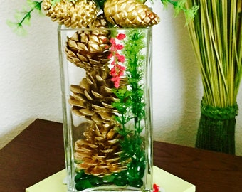 Decorative Gold Pine Cones in a glass vase