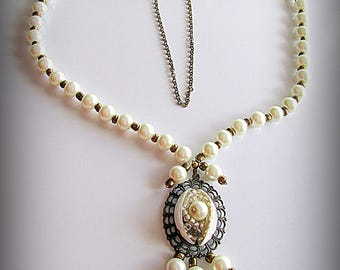 Artificial pearl beads and antique gold color necklace.