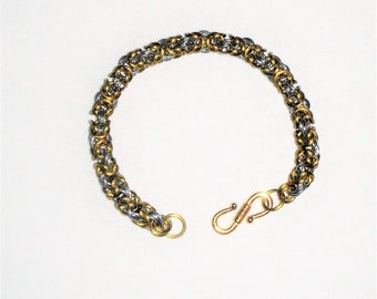Beautiful bright silver and gold toned Byzantine Weave Chain Maille Bracelet