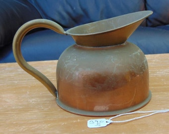 small copperware jug