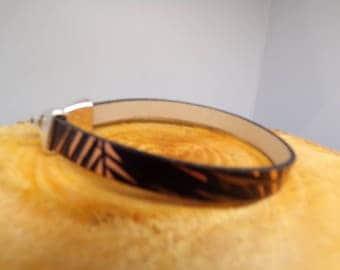 Flat black and gold cord bracelet