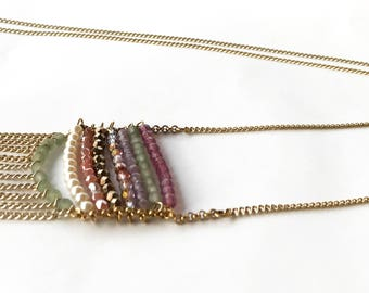 Necklace with colored glass beads and chain fringes