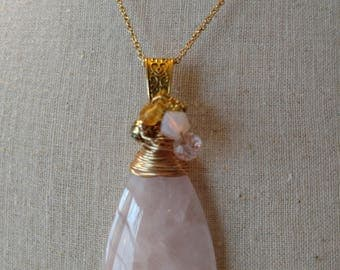 Pink rose quartz pendant necklace wire wrapped with gold colored wire