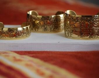 Cuff brass Aztec glyph