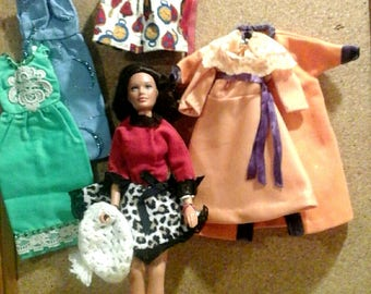 Vintage doll with 5 outfits