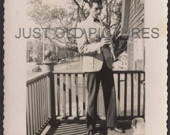 Man on porch playing clarinet for his dog old vintage photo/snapshot/photograph-w26
