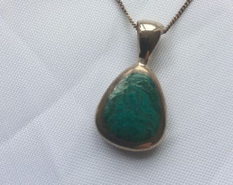 A Vintage Double Sided Malachite and Mother of Pearl Silver Pendant and Chain