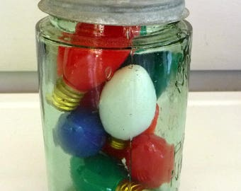 Vintage green pint mason jar with Christmas light bulbs