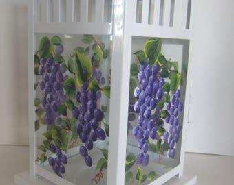 Purple Grapes on a White Metal Lantern