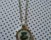 Mad Hatters hat Alice in Wonderland round silver pendant necklace