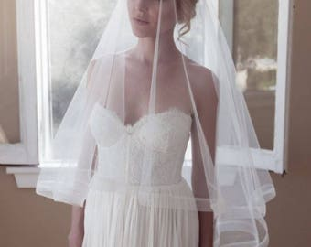 "Horsehair wedding veil in fingertip length of 40"" on a comb with 3"" wide horsehair edge in Drop Style bridal veil with plain edge"