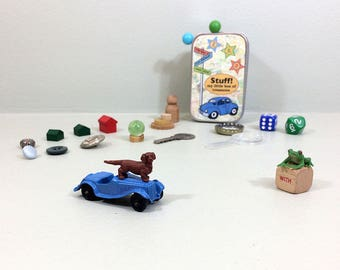 Child's treasure box of tiny toys. New & vintage items for learning and imagination play. Travel toys in a small tin box.