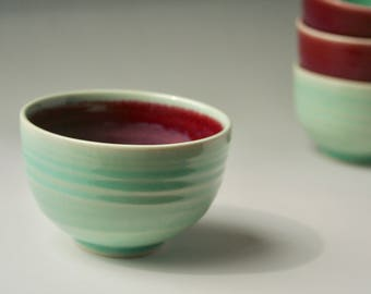 Small wheel thrown bowl in magenta and teal