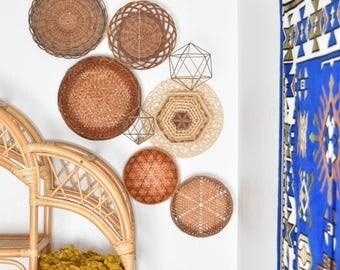 vintage set of 7 multicolored straw rattan wall baskets / orange