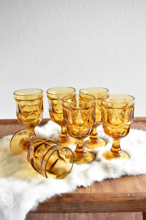 matching collection of amber glass champagne wine glass goblets / depression glass set