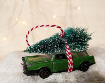 Green Family Vehicle Retro Matchbox Car with Tree Strapped to the Top Ornament by Distinguished Flamingo
