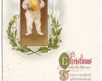 Little Boy in Pajamas with Ball Framed with Holly Leaves and Holly Berries Vintage Postcard Christmas Greetings