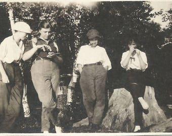"Vintage Snapshot ""Experimenting"" Teenage Girls Pipe Smoking Tobacco 1920's Sailor Hat Newsboy Cap Found Vernacular Photo"