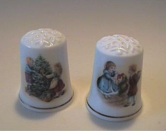 Two 1982 and 1984 vintage 1980's Avon Christmas thimbles